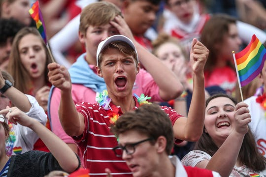 Southport Cardinals fans cheer for their team during the game against Roncalli at Southport High School on Friday, Aug. 17, 2018.