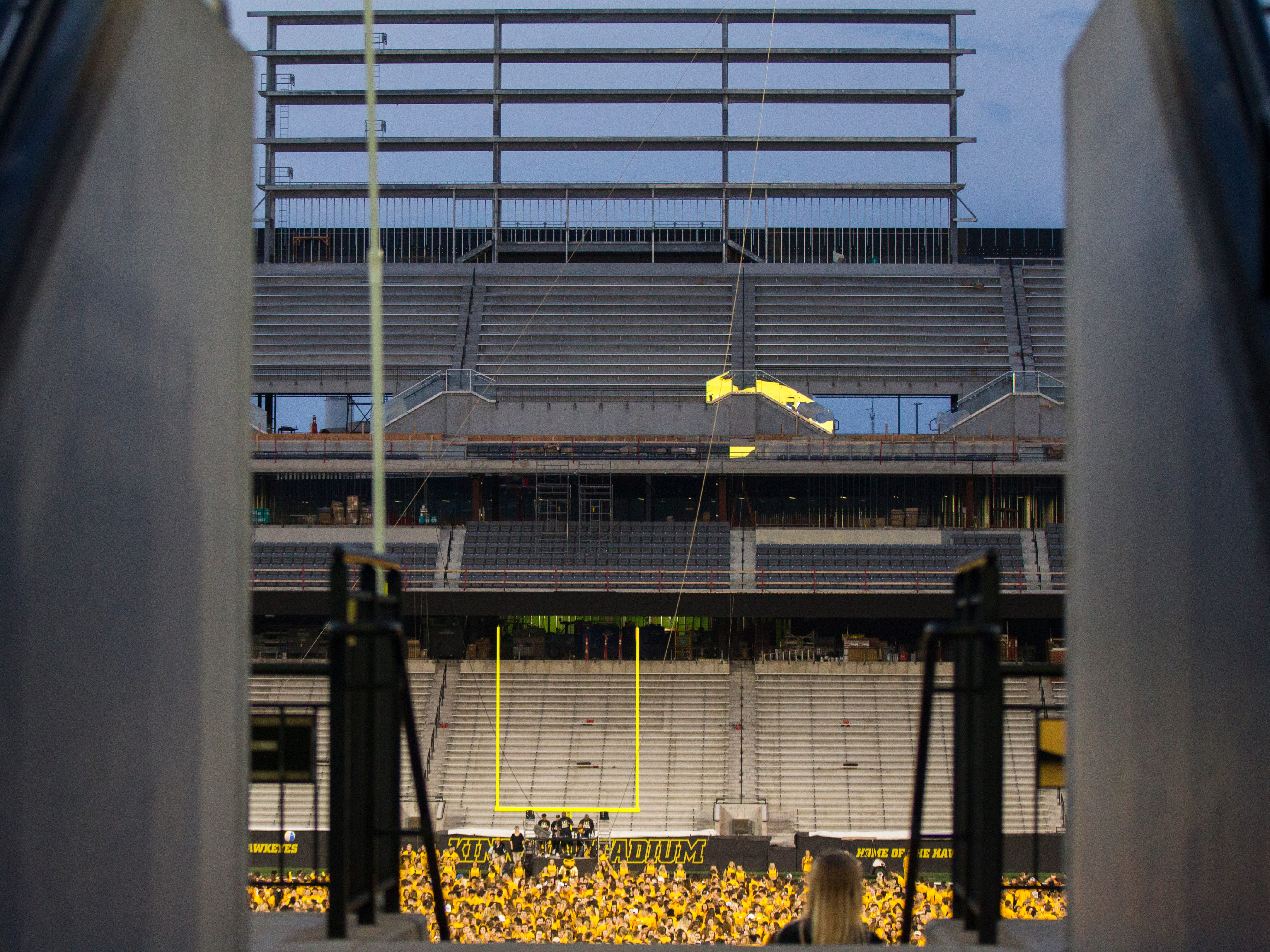 University of Iowa students gather during an OnIowa event on Friday, Aug. 17, 2018, at Kinnick Stadium in Iowa City. The annual Kickoff at Kinnick allows new students a chance to walk on the field for their class photo.