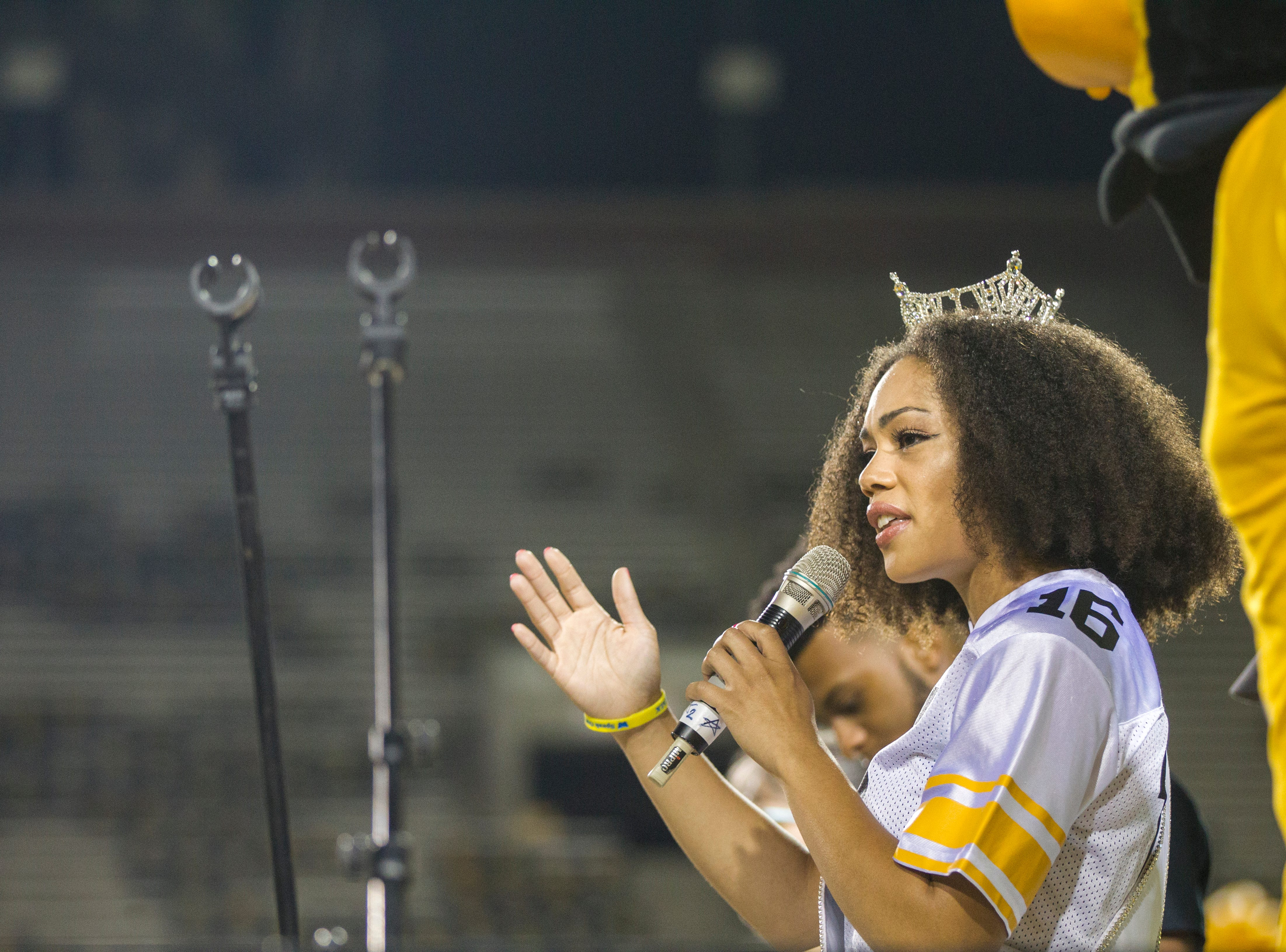 Mikhayla Hughes-Shaw, Miss Iowa 2018, speaks to University of Iowa students while they gather during an OnIowa event on Friday, Aug. 17, 2018, at Kinnick Stadium in Iowa City. The annual Kickoff at Kinnick allows new students a chance to walk on the field for their class photo.