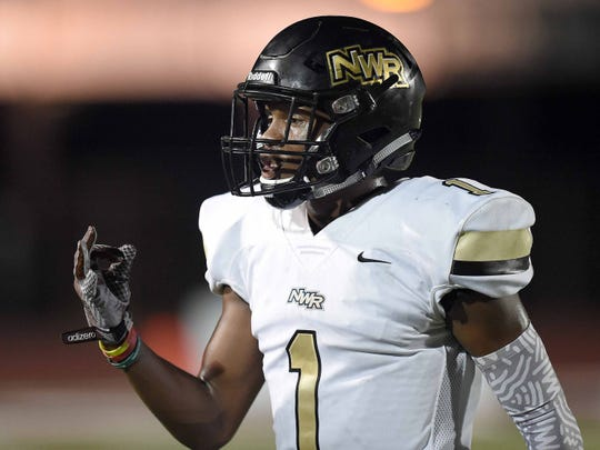 Northwest Rankin's Jarrian Jones (9) confirms the play call from the Cougars sideline on Friday, August 17, 2018, at Germantown High School in Gluckstadt, Miss.