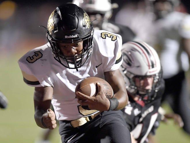 Northwest Rankin's P.J. Lindsey (3) score a touchdown against Germantown on Friday, August 17, 2018, at Germantown High School in Gluckstadt, Miss.