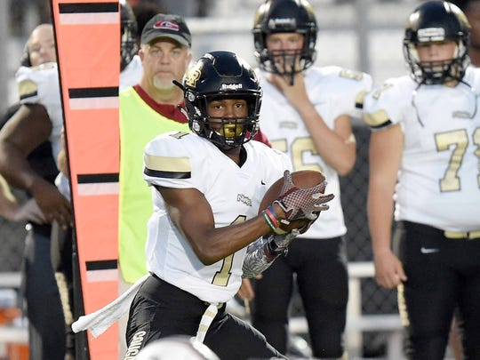 Northwest Rankin's Jarrian Jones (1) catches a pass along the sideline against Germantown on Friday, August 17, 2018, at Germantown High School in Gluckstadt, Miss.