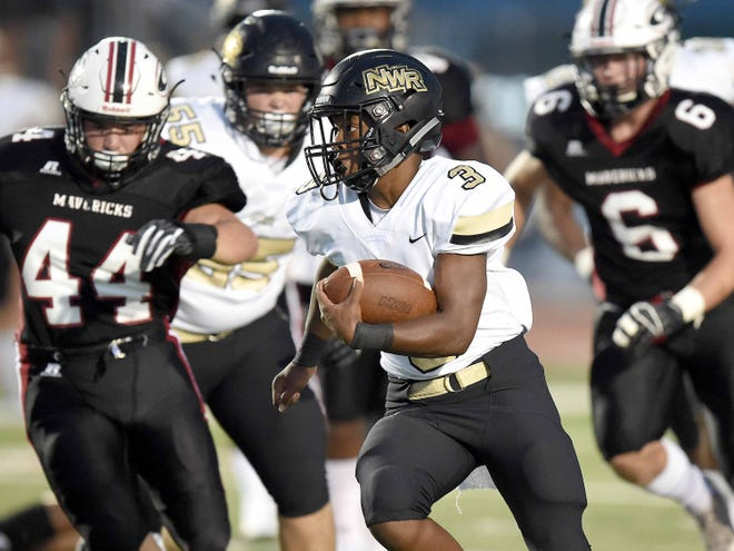 Northwest Rankin's P.J. Lindsey (3) breaks into the open for his first touchdown against Germantown on Friday, August 17, 2018, at Germantown High School in Gluckstadt, Miss.