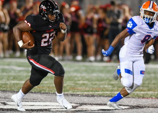 Brandon's Dallas Smith (22) runs the ball as Madison Central's Andre Mack (9) closes in at Brandon High School, Friday August 17, 2018.(Bob Smith-For The Clarion Ledger)