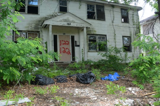 Several properties directly across from the Jackson Zoo lie in a state of disrepair and abandonment, including this parcel at 122 Moss Ave.