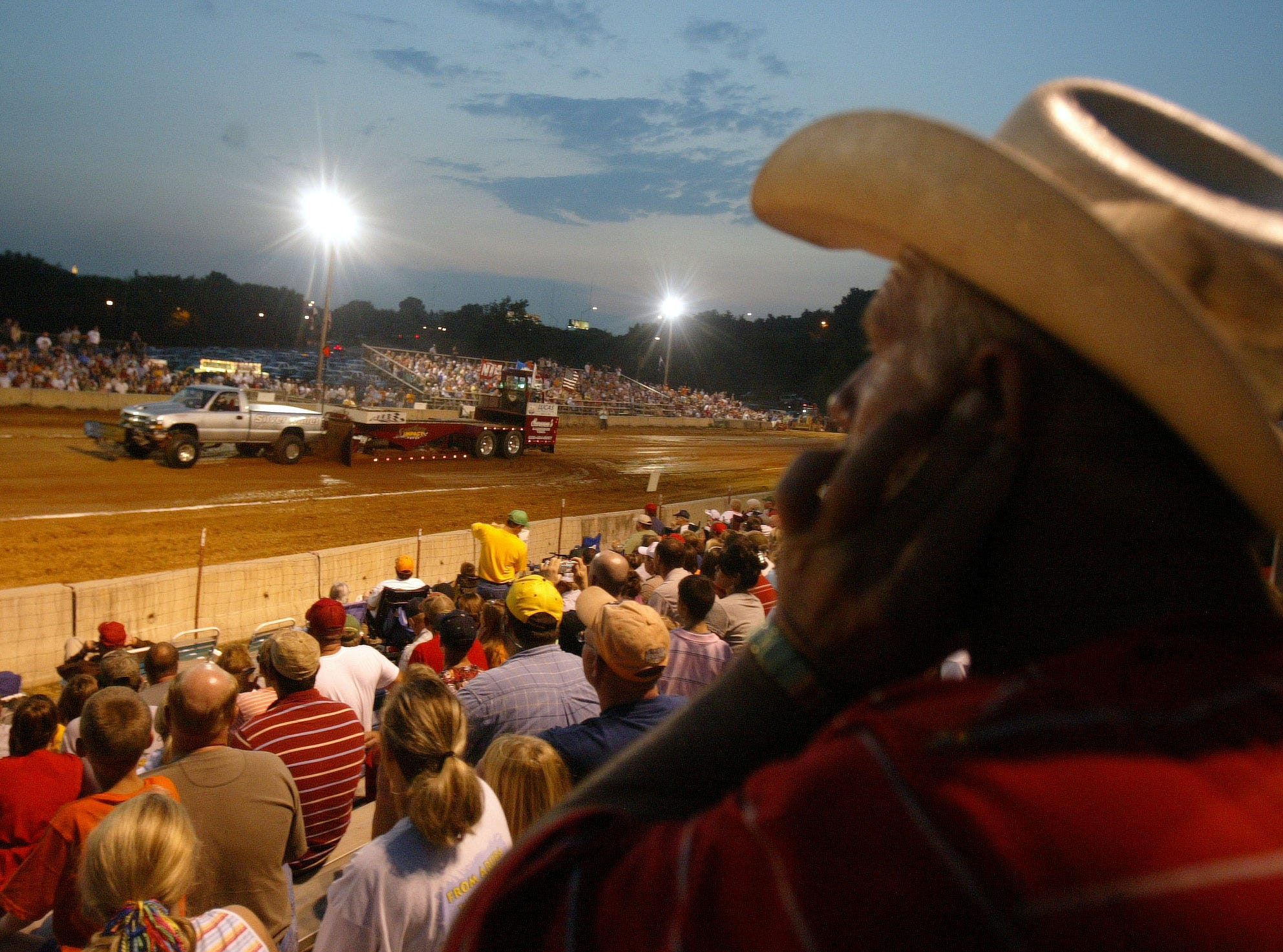 "Dennis Brown of Rutledge watches the truck and tractor pull on Friday at the Tennessee Valley Fair in 2006. A regular at the pull, Brown says he ""likes the competition. It boils down to who has the best mechanic."""