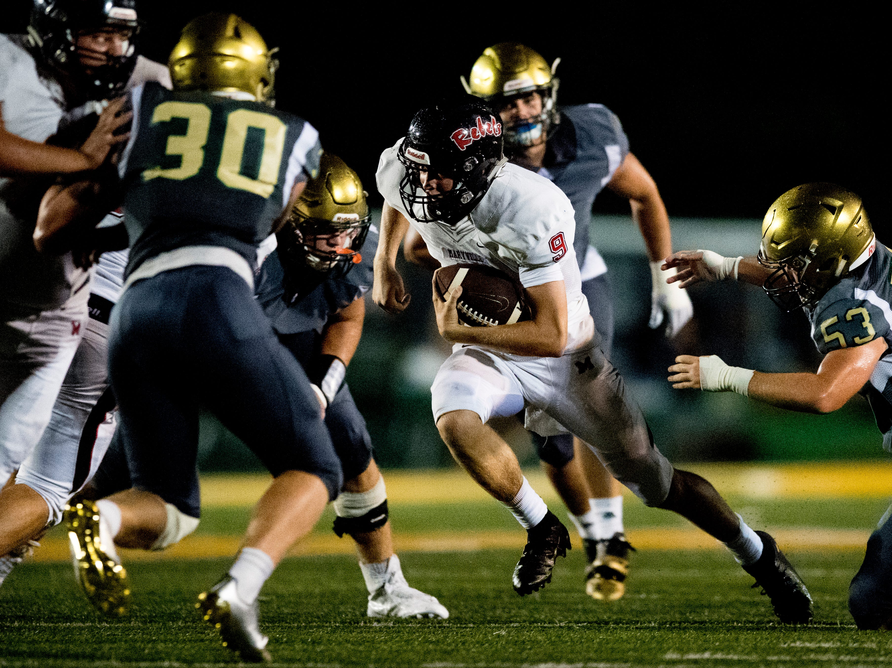 Maryville's Cade Chambers (9) runs through the defense during a football game between Maryville and Catholic at Catholic High School in Knoxville, Tennessee on Friday, August 17, 2018.