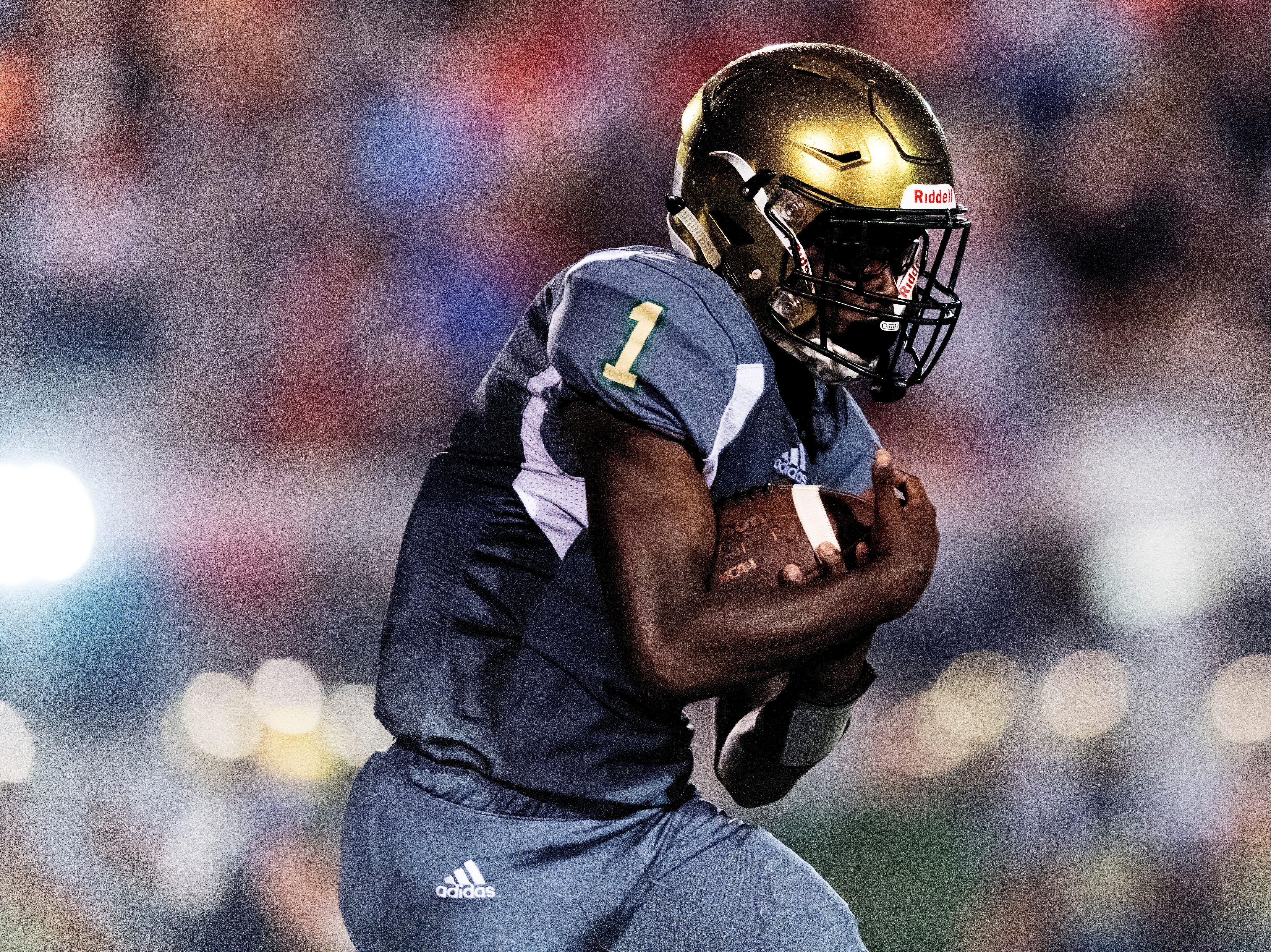 Catholic's Keondre' Jarmon (1) runs the ball down the field during a football game between Maryville and Catholic at Catholic High School in Knoxville, Tennessee on Friday, August 17, 2018.