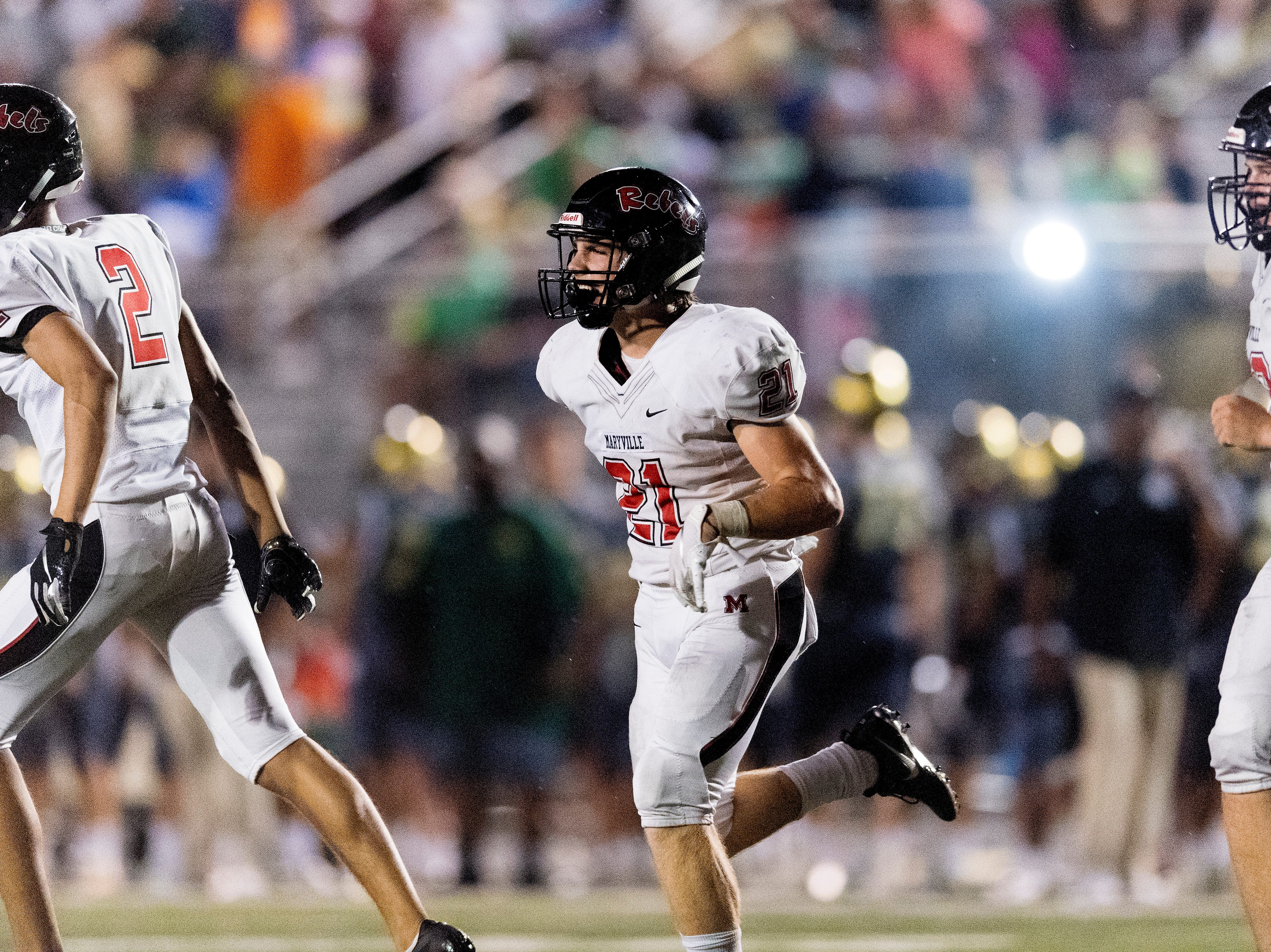 Maryville's Bryson Teffeteller (21) reacts after scoring a touchdown during a football game between Maryville and Catholic at Catholic High School in Knoxville, Tennessee on Friday, August 17, 2018.
