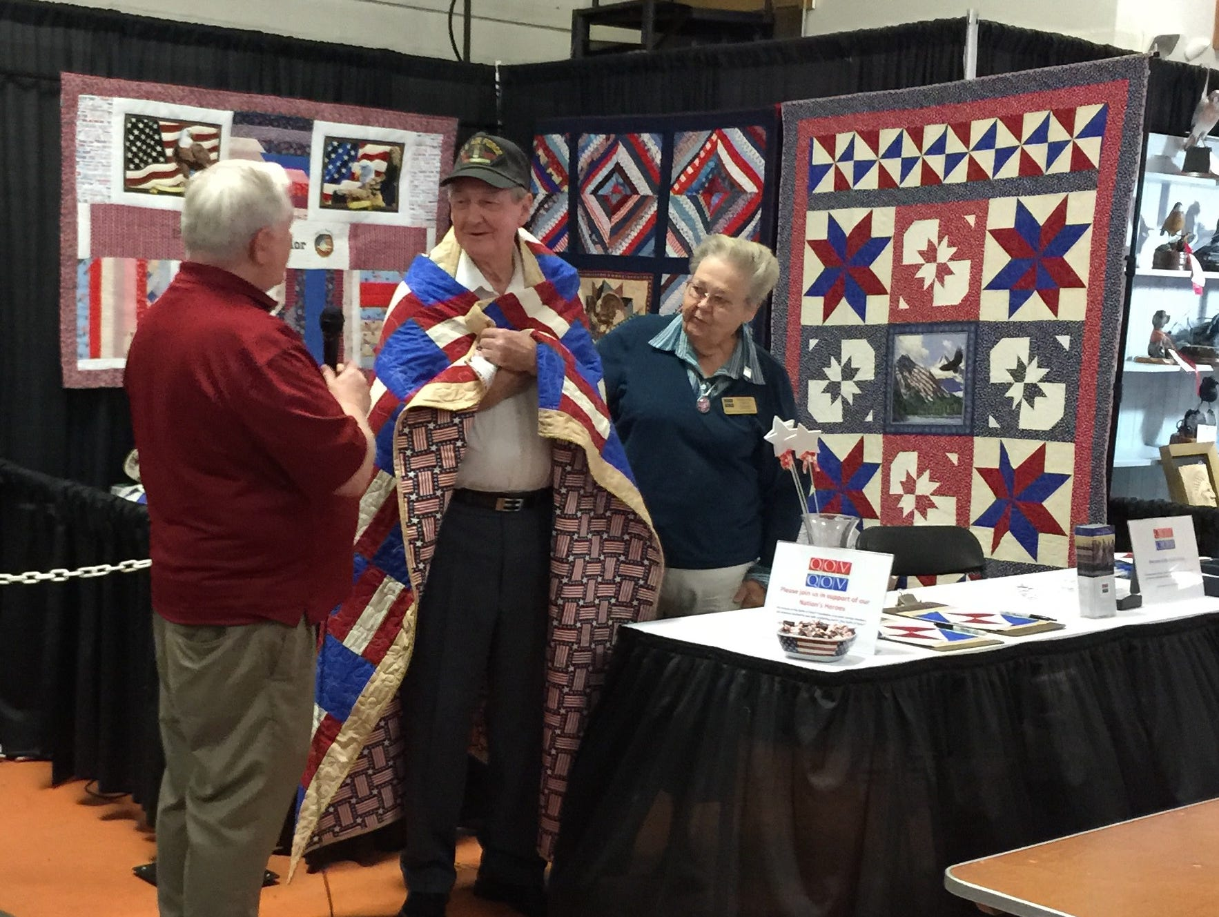 Veteran Raymond Hopper of Knoxville receives a quilt from Quilts of Valor on Saturday at the Tennessee Valley Fair.