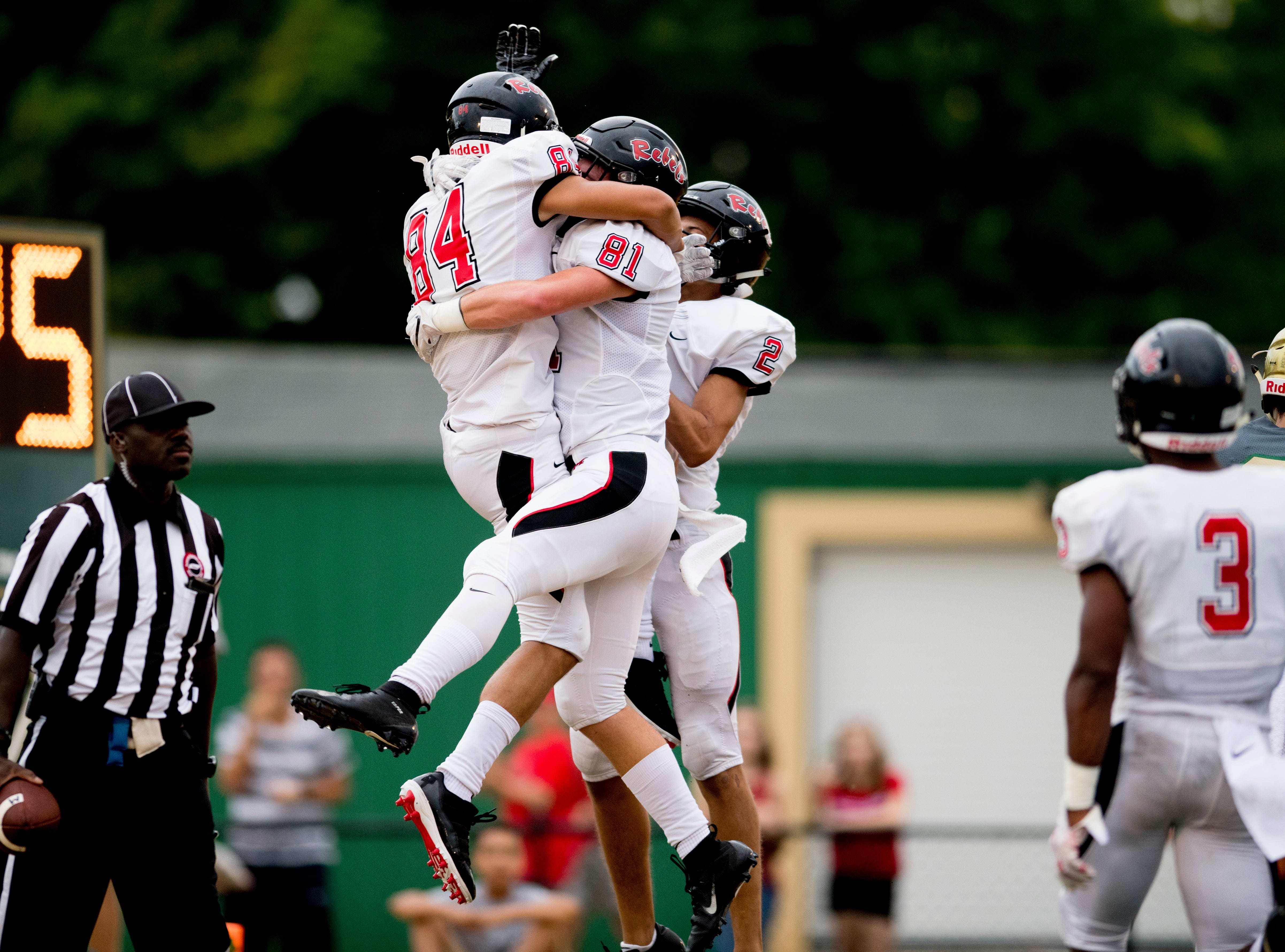 Maryville's Brayden Anderson (84) and Maryville's Brody Sloan (81) celebrate a touchdown in the end zone during a football game between Maryville and Catholic at Catholic High School in Knoxville, Tennessee on Friday, August 17, 2018.