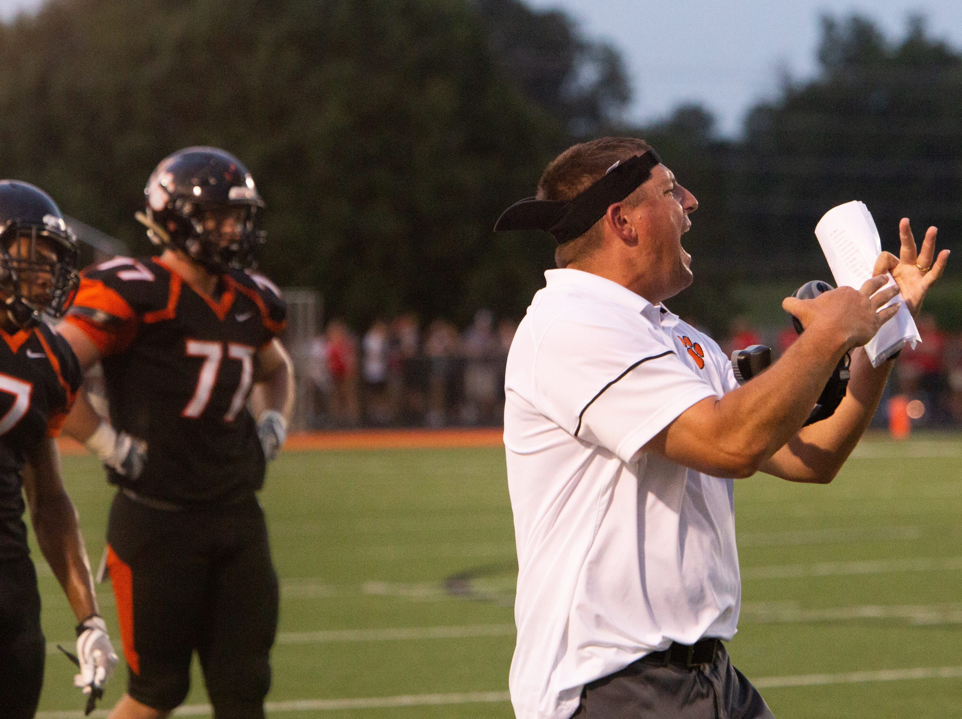 Powell head coach Matt Lowe calls a timeout during the Powell versus Halls football game at Powell High School Friday, Aug. 17, 2018.