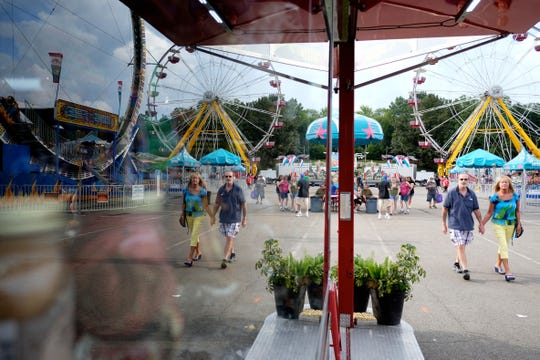 Fair attendees are seen walking the fair grounds during the 2014 Tennessee Valley Fair in Knoxville, Tenn., on Friday, September 5, 2014.