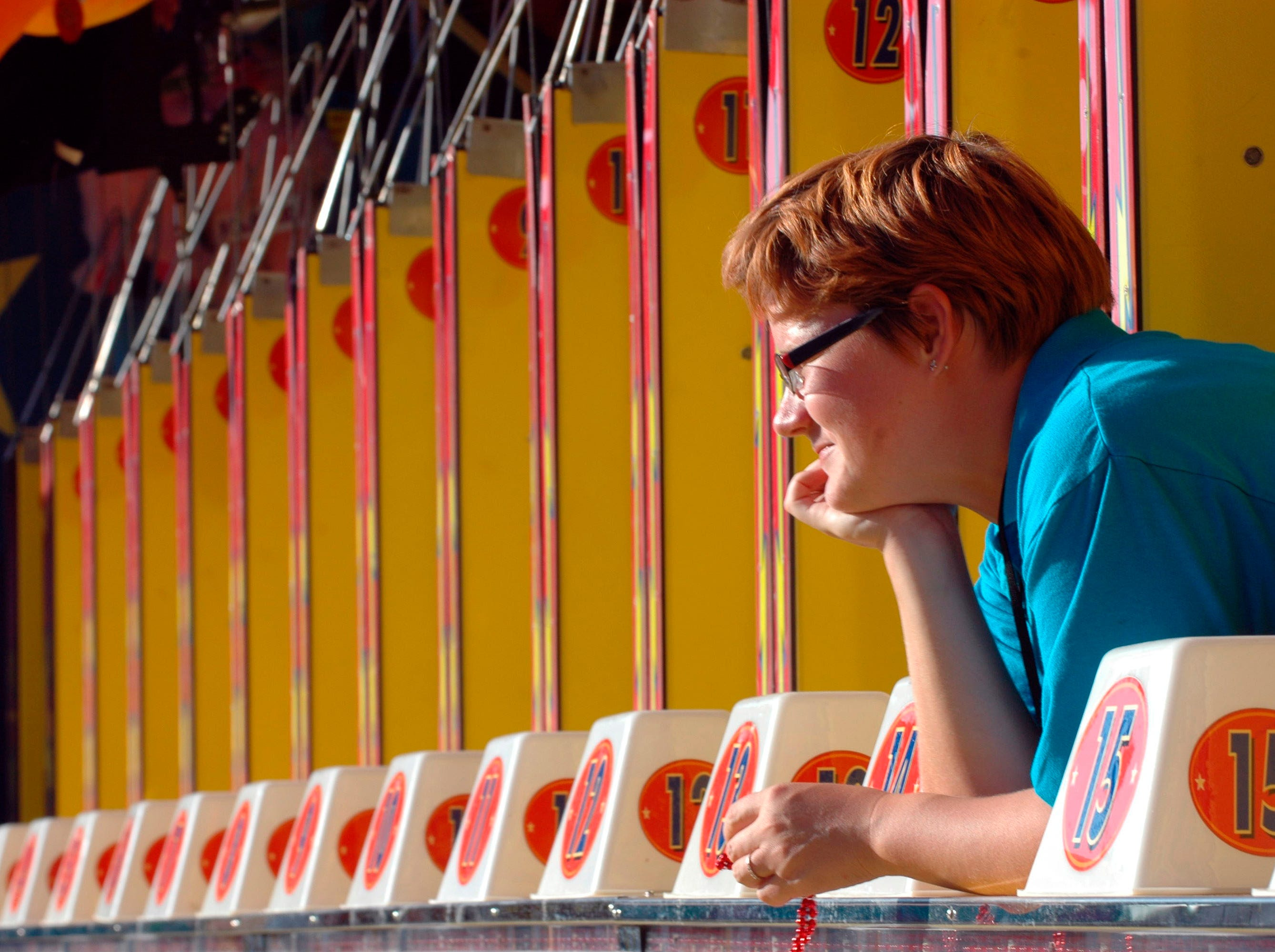 Anna Shabanova (CQ) of Russia, peers out at the crowd of fairgoers from her booth. The Tennessee Valley Fair was held at the Chilhowee Park and opened on Friday, August 5, 2008.