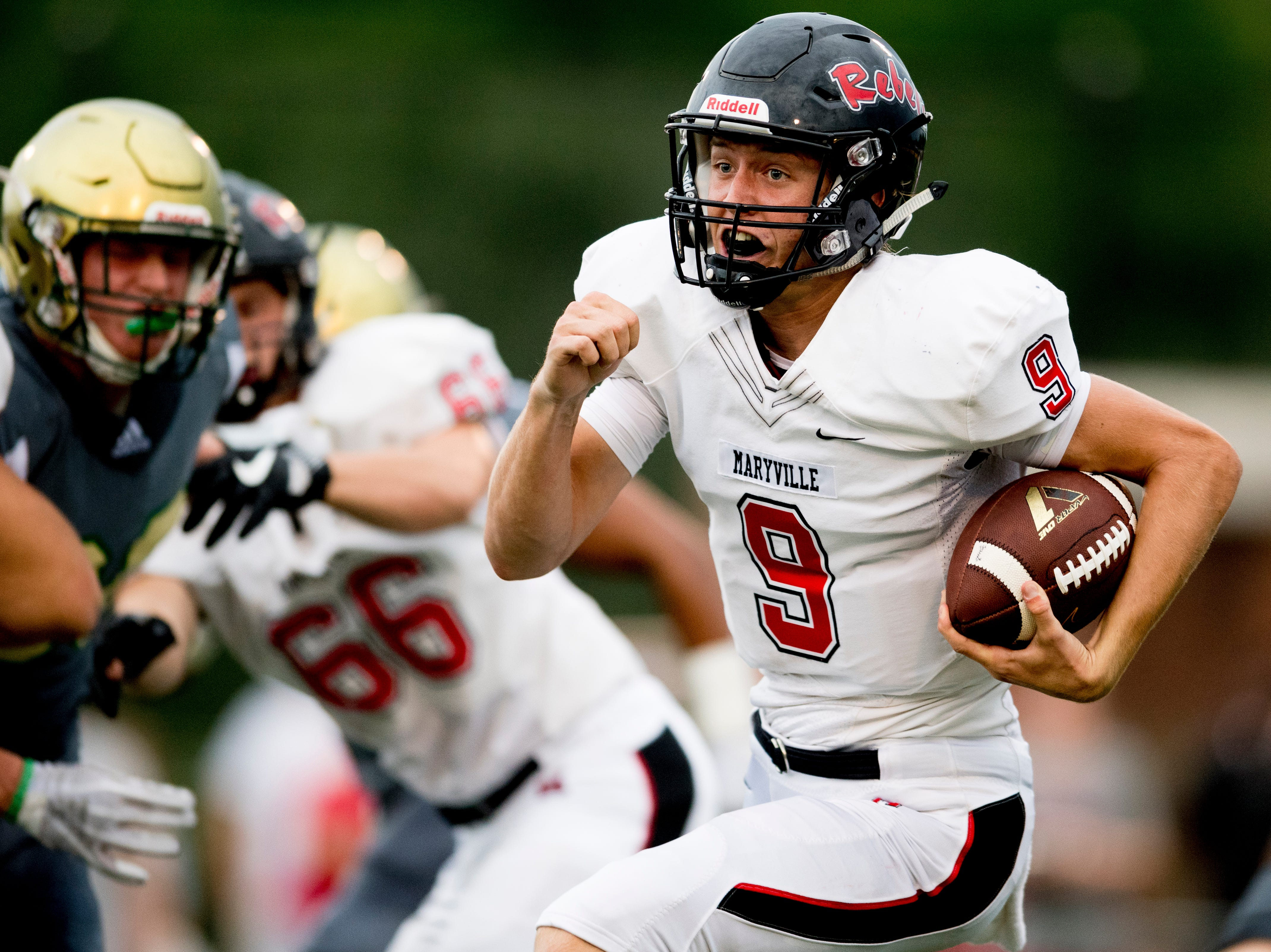 Maryville's Cade Chambers (9) runs down the field with the ball during a football game between Maryville and Catholic at Catholic High School in Knoxville, Tennessee on Friday, August 17, 2018.