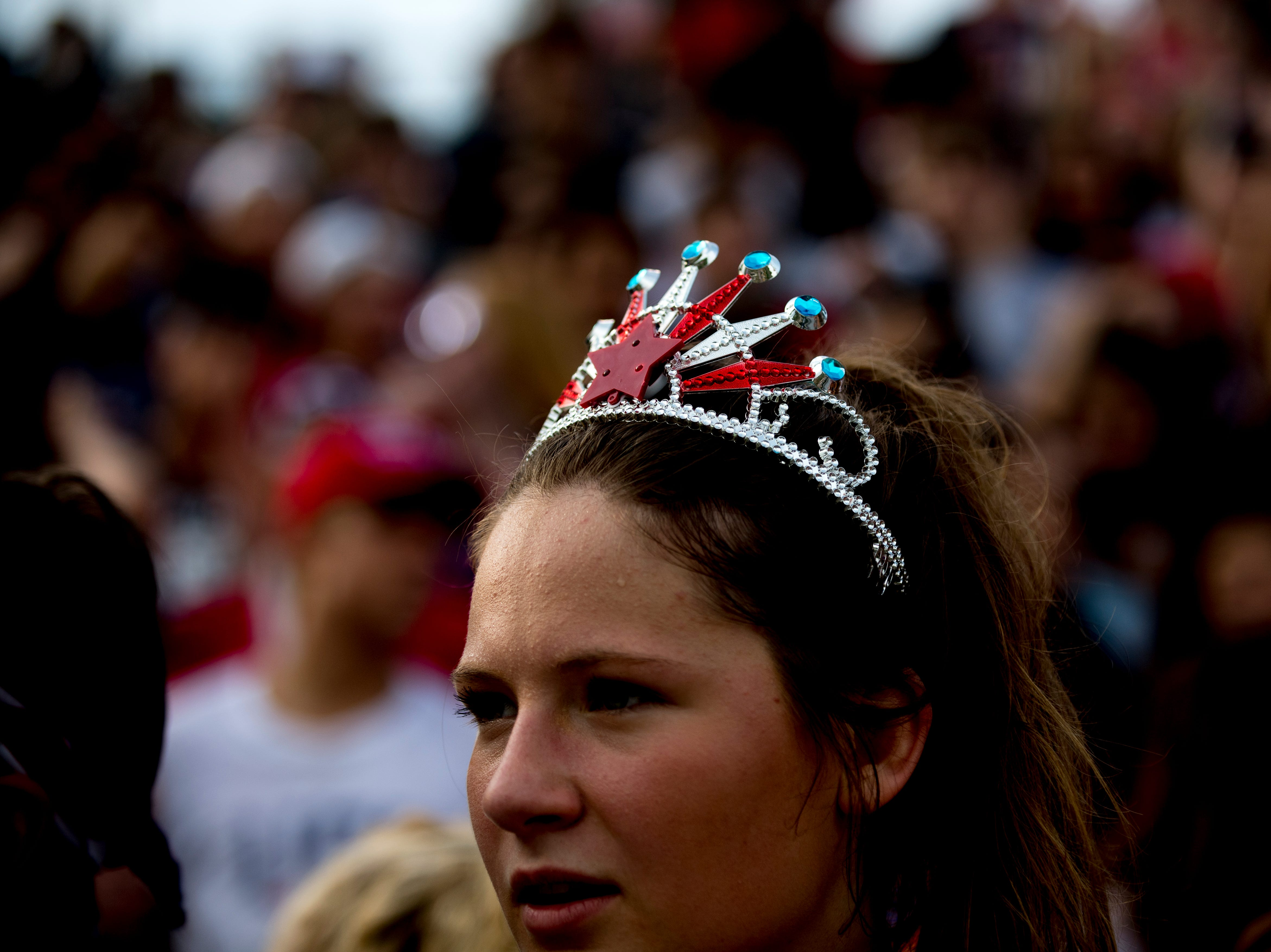 A fan in the Catholic student sections wears a tiara during a football game between Maryville and Catholic at Catholic High School in Knoxville, Tennessee on Friday, August 17, 2018.
