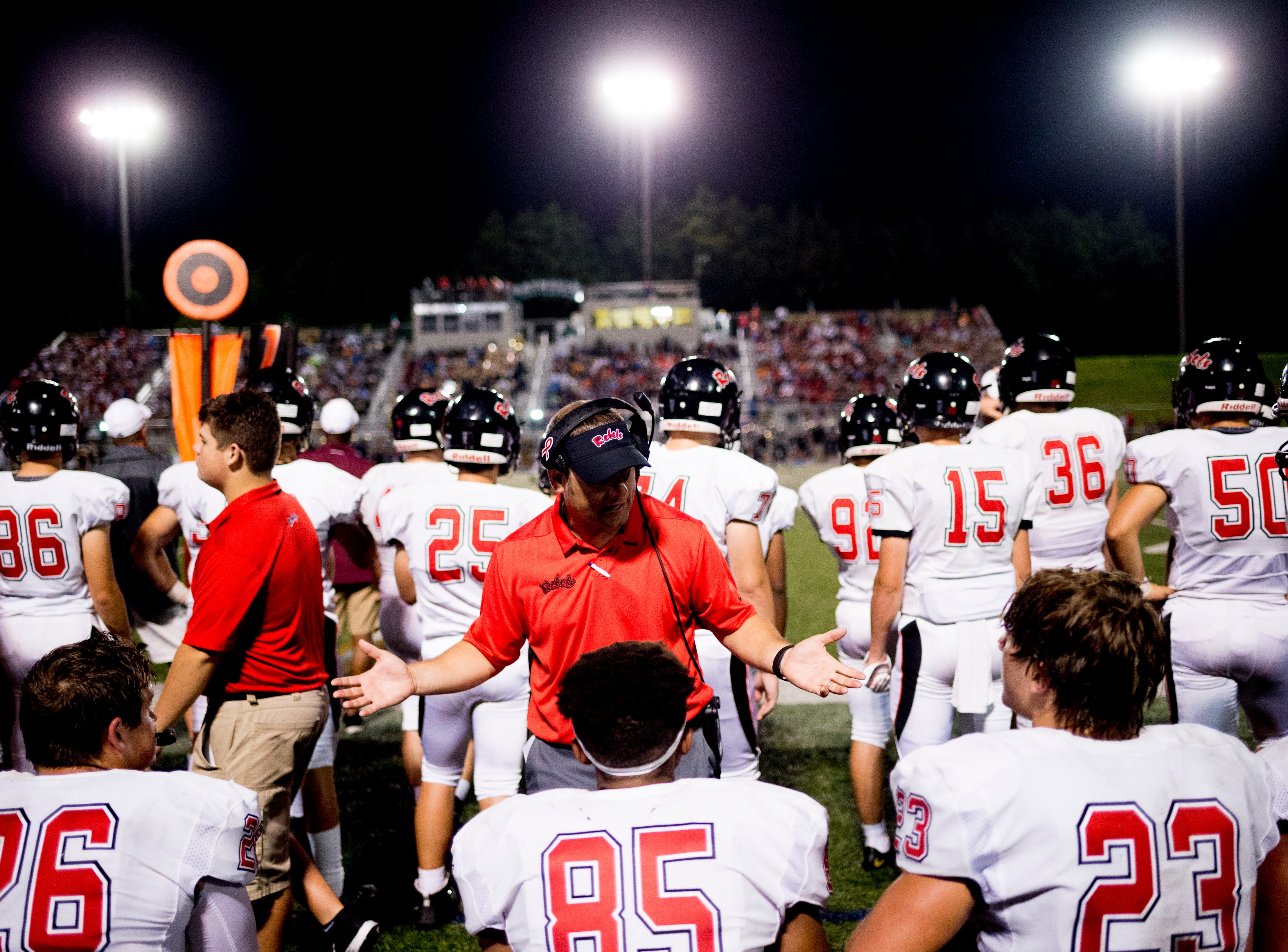 Maryville's Seth Orren (26), Maryville's Matthew Brooks (85) and Maryville's Mason Shelton (23) speak with a coach during a football game between Maryville and Catholic at Catholic High School in Knoxville, Tennessee on Friday, August 17, 2018.