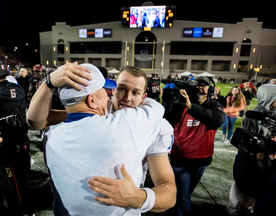 "FILE - In this Dec. 16, 2017, file photo, Middle Tennessee head coach Rick Stockstill hugs his son, quarterback Brent Stockstill (12), after beating Arkansas State in the Camellia Bowl NCAA college football game in Montgomery, Ala. Stockstill goes into his senior season already as the Blue Raiders career leader in touchdown passes (77) and 300-yard passing games (14). ""It's everything that I wanted it to be, and more,"" said the younger Stockstill, who plans to be a coach like his dad. ""We've grown closer and closer and really tried to just do it the right way and show people that it's a special opportunity."" (Mickey Welsh/The Montgomery Advertiser via AP, File)"