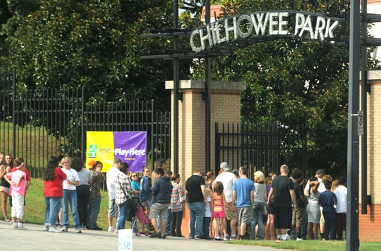Fairgoers line the sidewalk to enter Chilhowee Park for the Tennessee Valley Fair's opening day on Friday, Sept. 11, 2015.