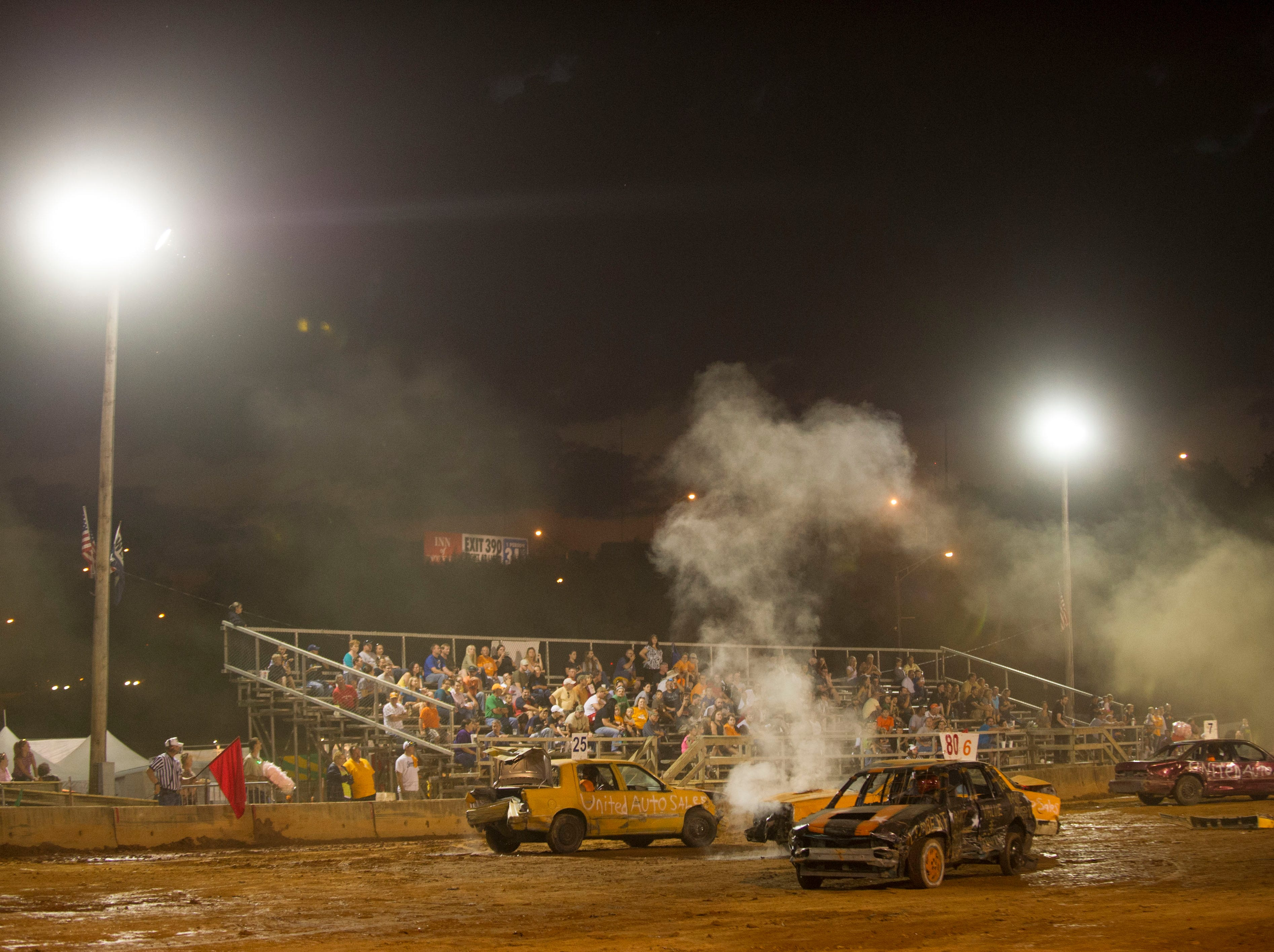 Drivers participate in the demolition derby at the Tennessee Valley Fair Wednesday, Sept. 12, 2012.