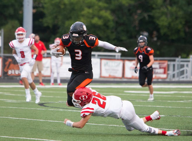 Powell junior Bailor Walker (3) attempts to leap over Halls Senior Justin Peters (26) during the Powell versus Halls football game at Powell High School Friday, Aug. 17, 2018.