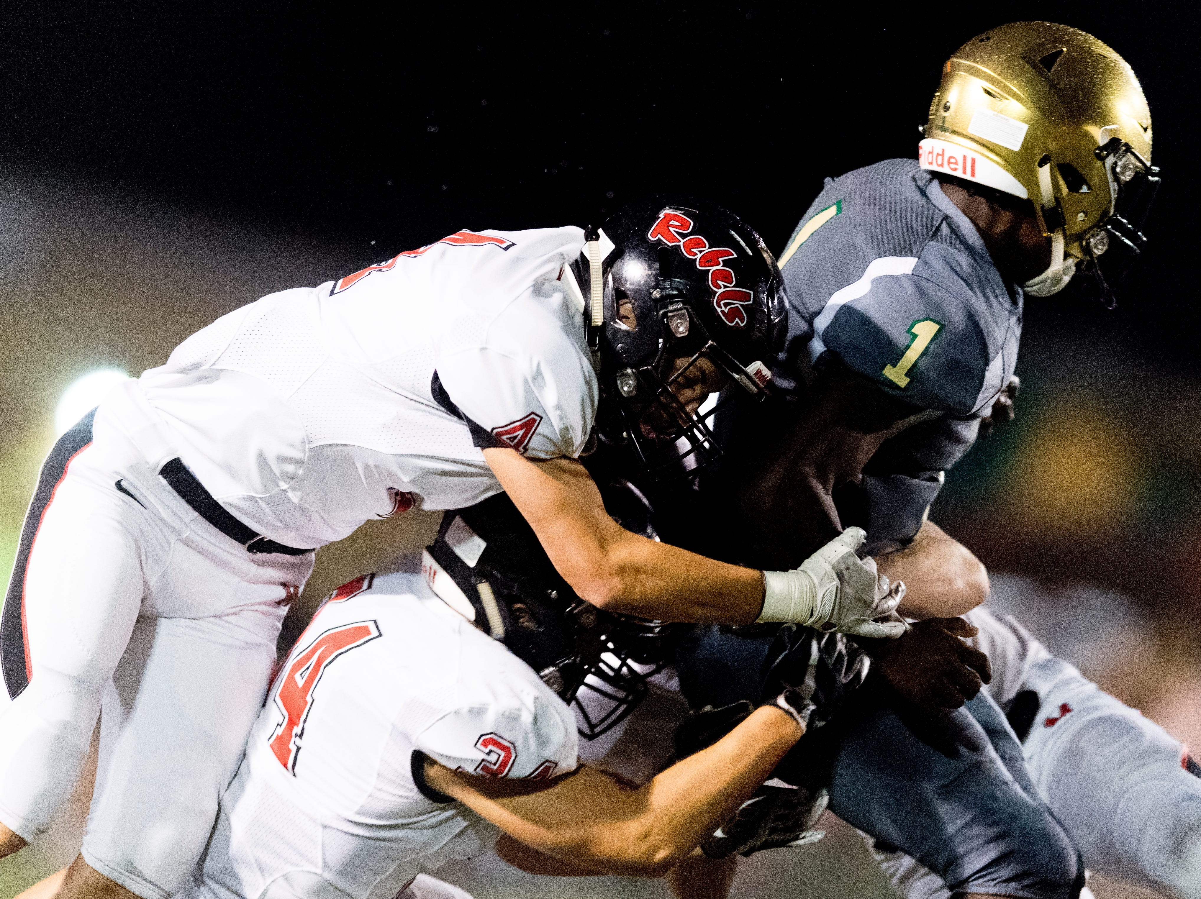 Catholic's Keondre' Jarmon (1) is tackled by Maryville's Drew Crowder (4) and Maryville's Sean Ward (34) during a football game between Maryville and Catholic at Catholic High School in Knoxville, Tennessee on Friday, August 17, 2018.