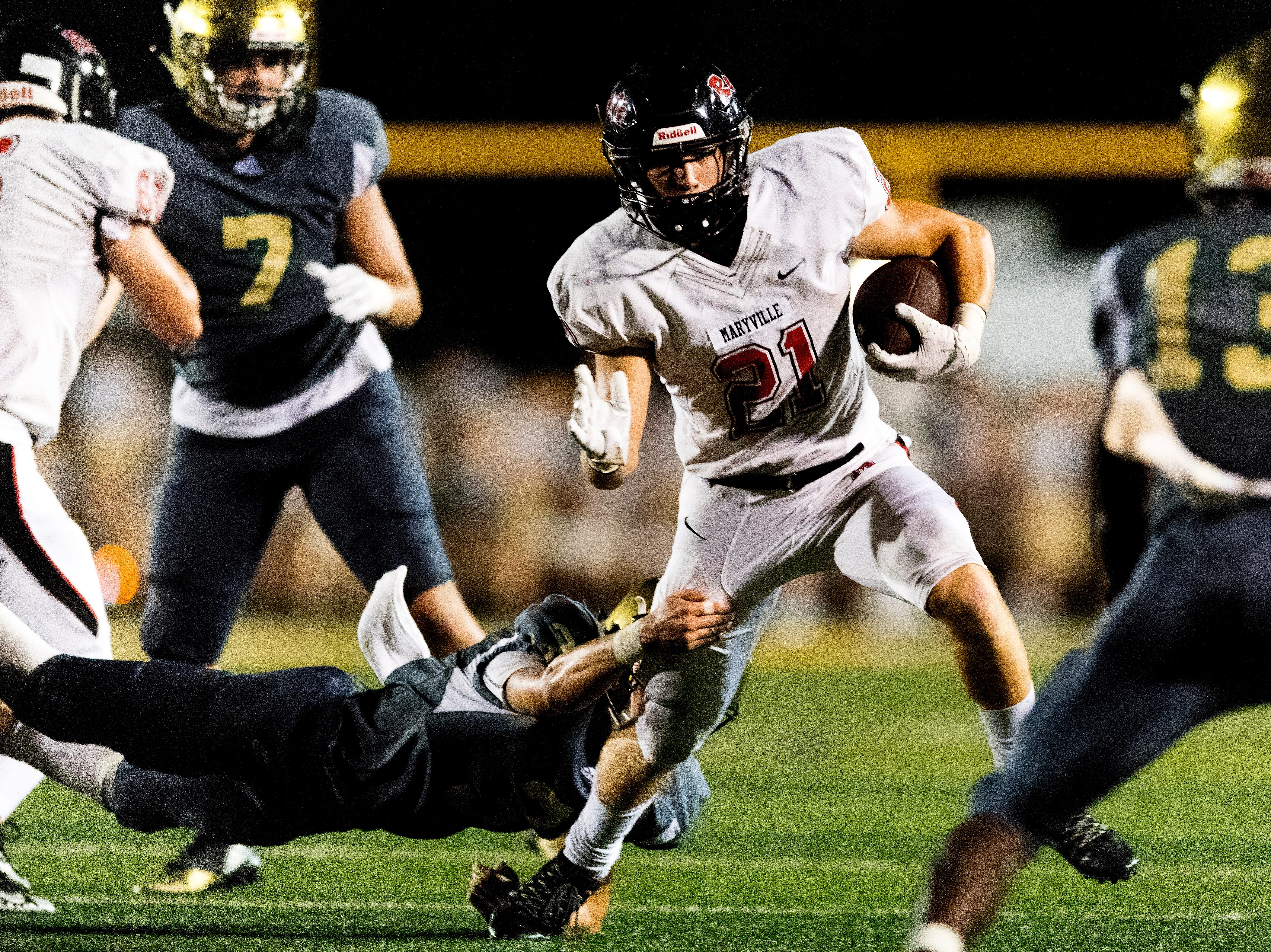 Maryville's Bryson Teffeteller (21) runs past the Catholic defense during a football game between Maryville and Catholic at Catholic High School in Knoxville, Tennessee on Friday, August 17, 2018.