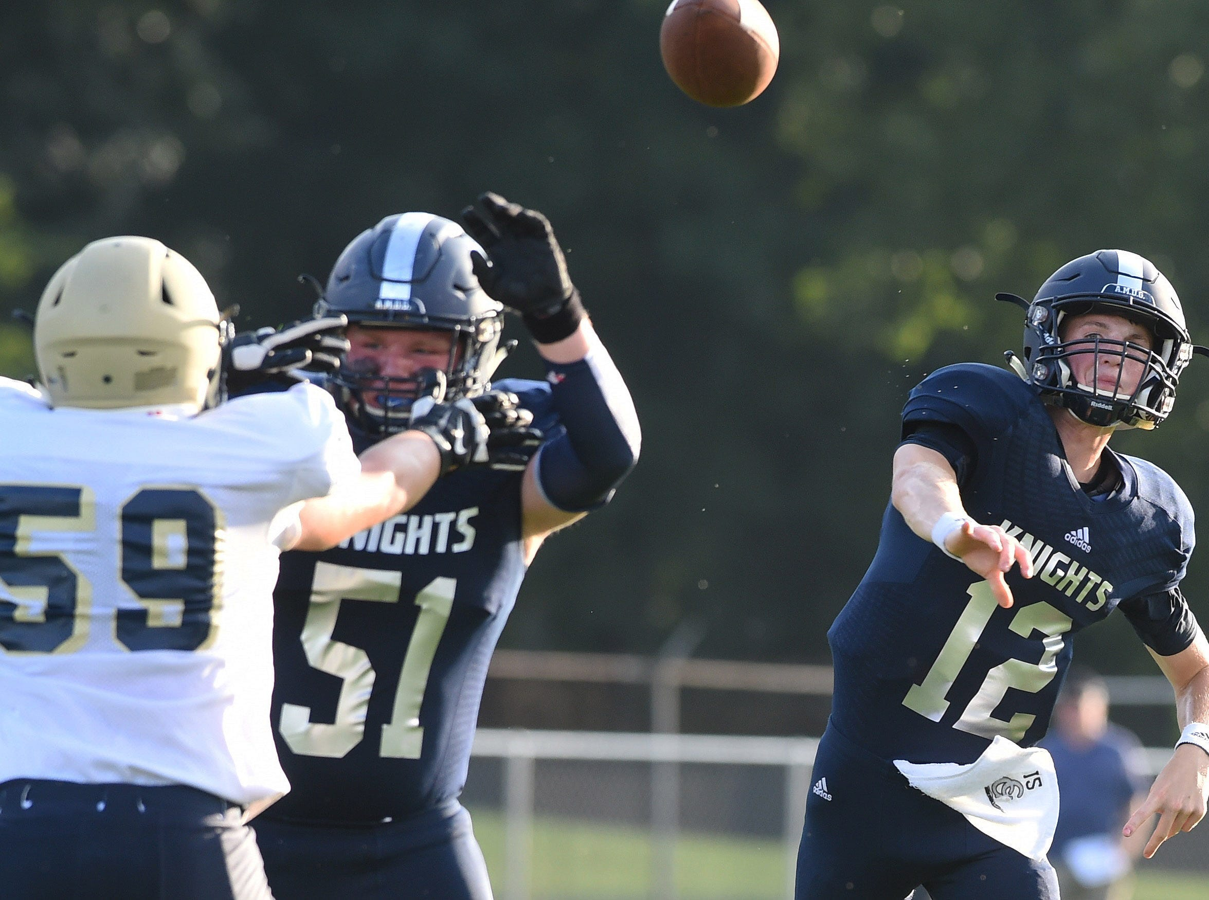 Central Catholic quarterback Wes Dulin has time to throw thanks to the blocking of left guard Noah Eversman (51).