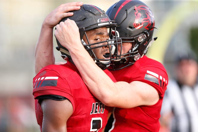 Lafayette Jeff quarterback Maximus Grimes celebrates with Derrick Matthews after the tow connected on a touchdown pass to tie the score at 7-7 against West Lafayette Friday, August 17, 2018, at Gordon Straley Field in West Lafayette.