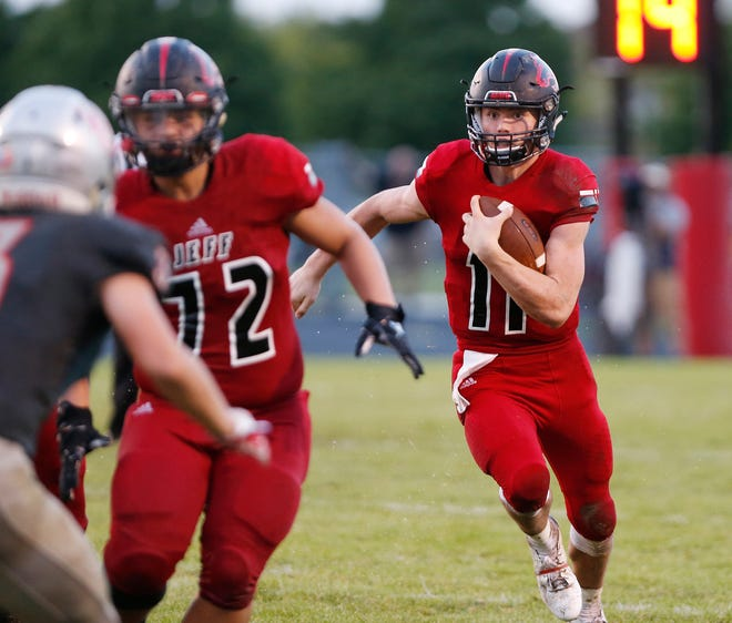 Lafayette Jeff quarterback Maximus Grimes with a carry against West Lafayette Friday, August 17, 2018, at Gordon Straley Field in West Lafayette. West Lafayette defeated Jeff 38-29.