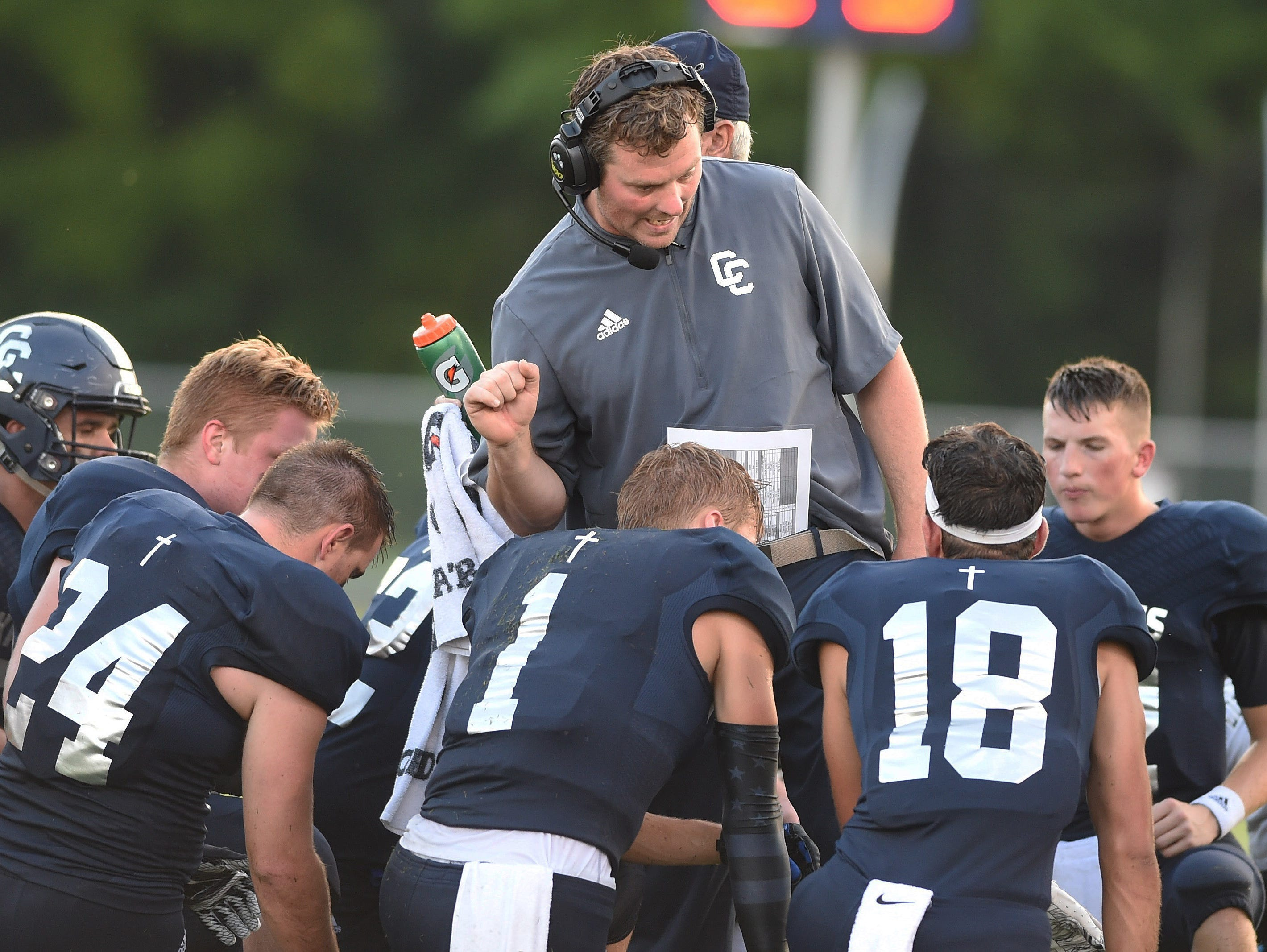 Central Catholic coach Brian Nay talks to his team during a break in the season opener against Tri-West.