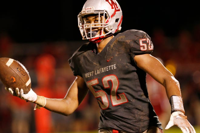 Tavion Woodard of West Lafayette celebrates after recovering a Lafayette Jeff fumble with 4:42 remaining Friday, August 17, 2018, at Gordon Straley Field in West Lafayette. West Lafayette defeated Jeff 38-29.