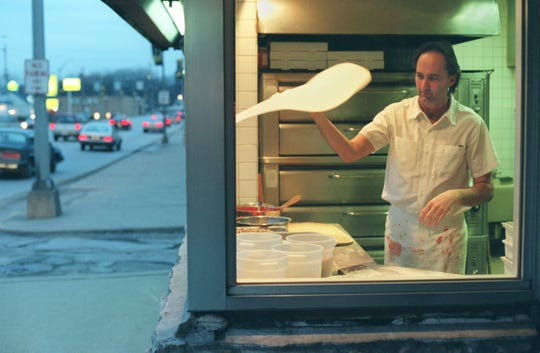 In this 1998 photo, Bruno Itin Jr. tosses a pizza in the kitchen of Bruno's Swiss Inn . Soon after, Bruno's moved a block away to Brown Street in the West Lafayette levee area. Construction of the U.S. 231 bypass forced the move.
