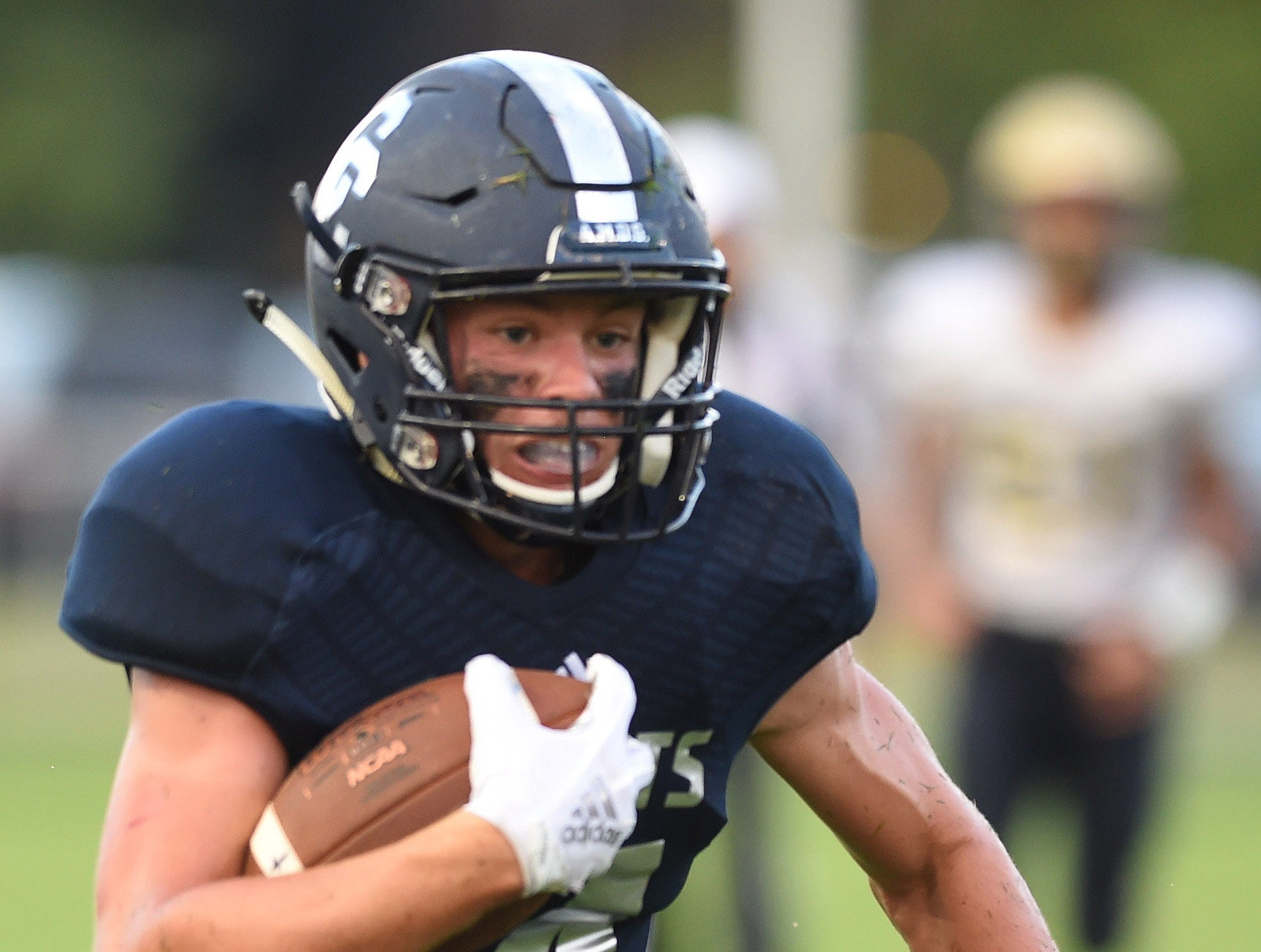Central  Catholic running back Ky Schrader breaks into the open.