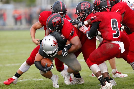 Lafayette Jeff's defense wraps up Sage Hood in the first half.