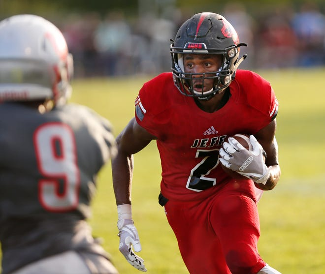 Derrick Matthews of Lafayette Jeff with a pass reception against West Lafayette Friday, August 17, 2018, at Gordon Straley Field in West Lafayette. West Lafayette defeated Jeff 38-29.