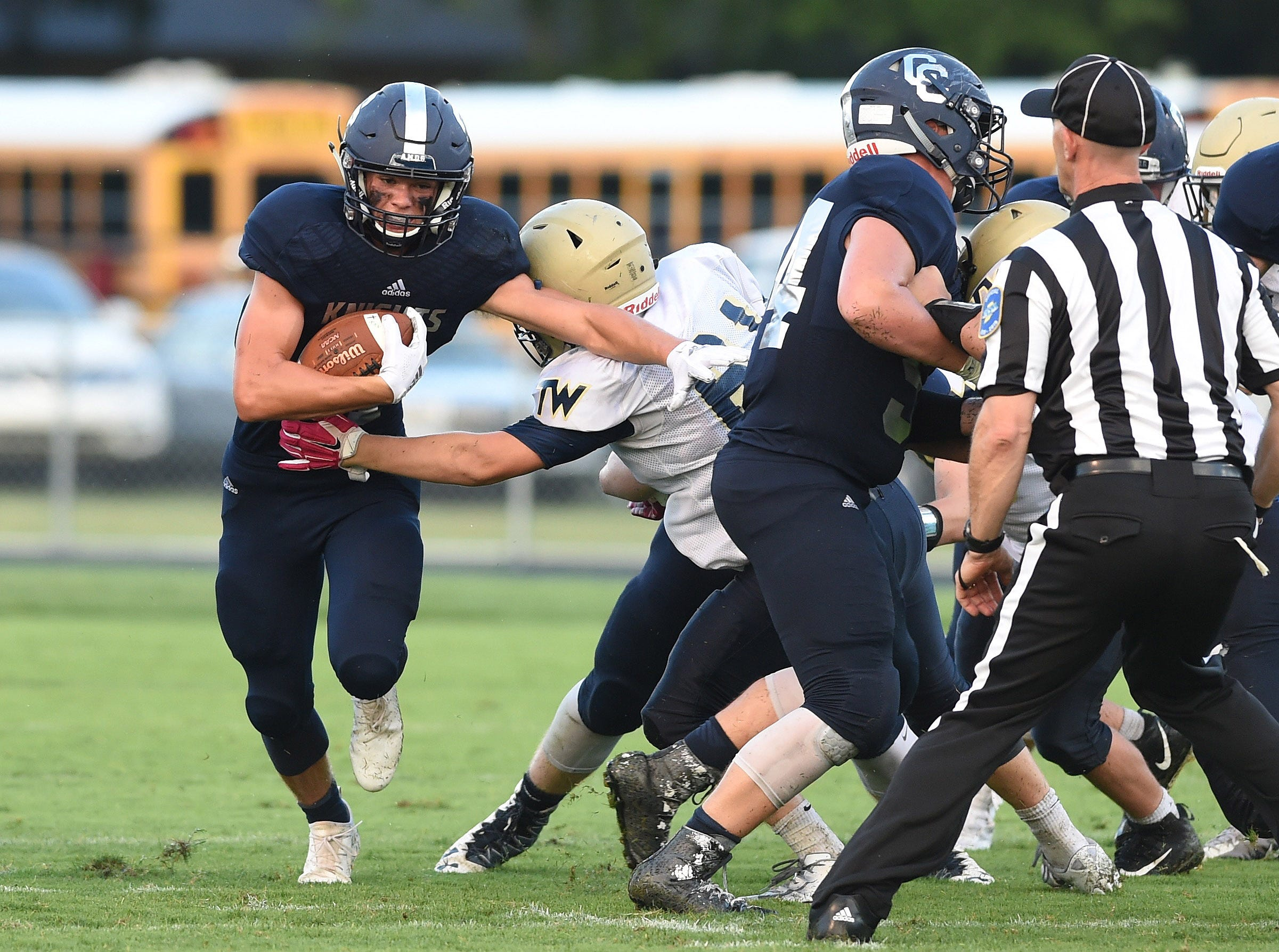 Scenes from a soggy Central Catholic Friday night as the Knights take on Tri-West.