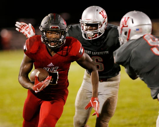 Brian Jenkins of Lafayette Jeff with a carry against West Lafayette Friday, August 17, 2018, at Gordon Straley Field in West Lafayette. West Lafayette defeated Jeff 38-29.