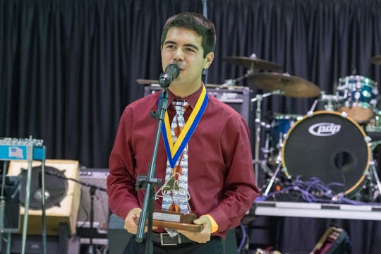 Zach Fuselier accepts award for Fiddler of the year at the Cajun French Music Association hosts the 30th annual awards ceremony. Friday, Aug. 17, 2018.