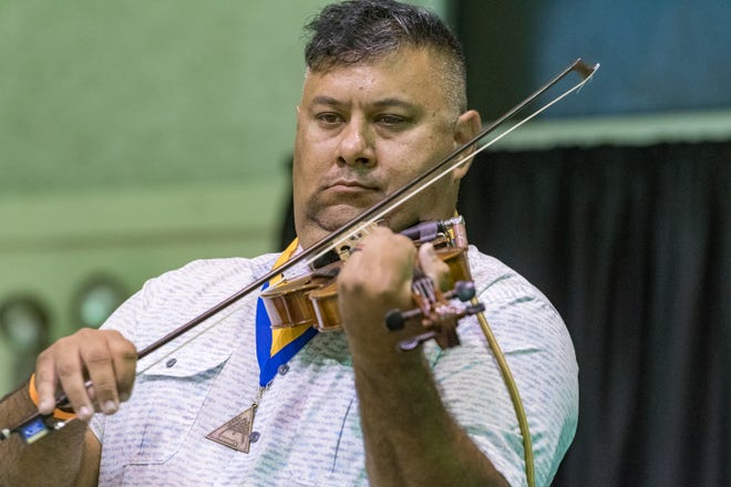 Clint Ward playing the fiddle at the Cajun French Music Association hosts the 30th annual awards ceremony. Friday, Aug. 17, 2018.