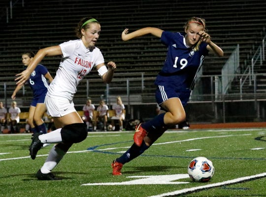 Fairfied Union's Reagan Conrad, left, Lancaster's Isabella Galecki chase down the ball Friday night, Aug. 17, 2018, during the Golden Gales 1-0 victory at Fulton Field in Lancaster.