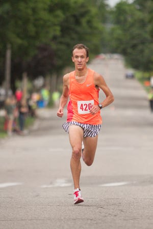 Patrick Miller of Howell runs alone up front as he wins the Howell Melon Run 5K for the third time in five years on Friday, Aug. 17, 2018.