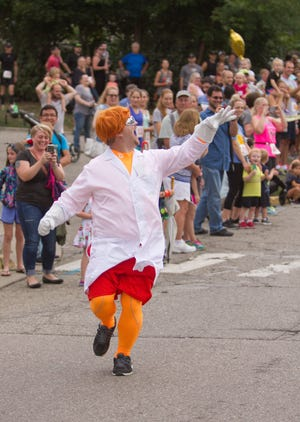 With Howell Melon Festival canceled due to COVID-19, the 2020 Mascot Challenge will be held virtually. In the image, The Element mascot from Chem Trend took his time to make his presence noticed in the Mascot Dash Friday, Aug. 17, 2018 during the Howell Melon Festival.