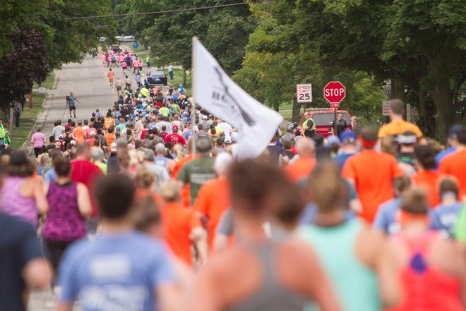 About 600 runners fill Clinton Street near the start of the Howell Melon Run on Friday, Aug. 17, 2018.