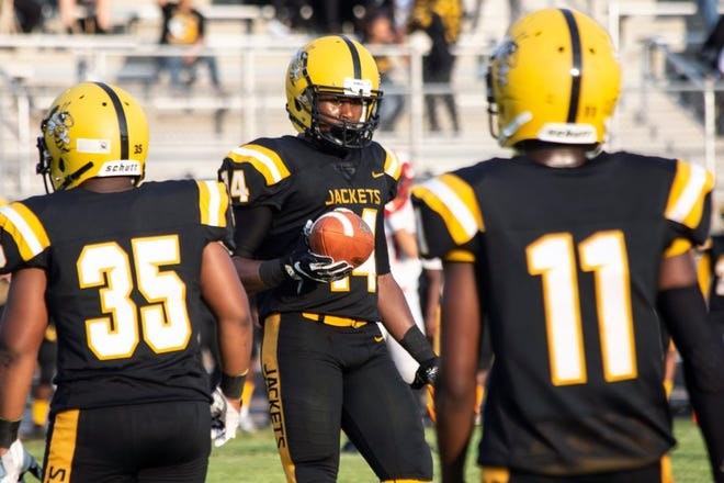 Central's U'Kari Baker returns to the field after a touchdown to play defense for Central against Manual on Friday night. 8/17/18