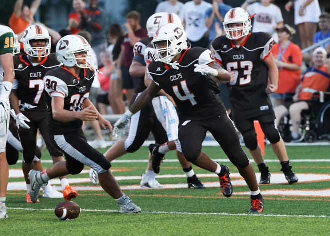 DeSales Antione Johnson (4) celebrated scoring a touchdown against St. X at DeSales High School.Aug. 17, 2018