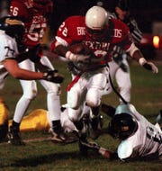 Shawn Foster, one of the many stars of the Sexton-Eastern rivalry, breaks through Eastern's defensive line in 1996.