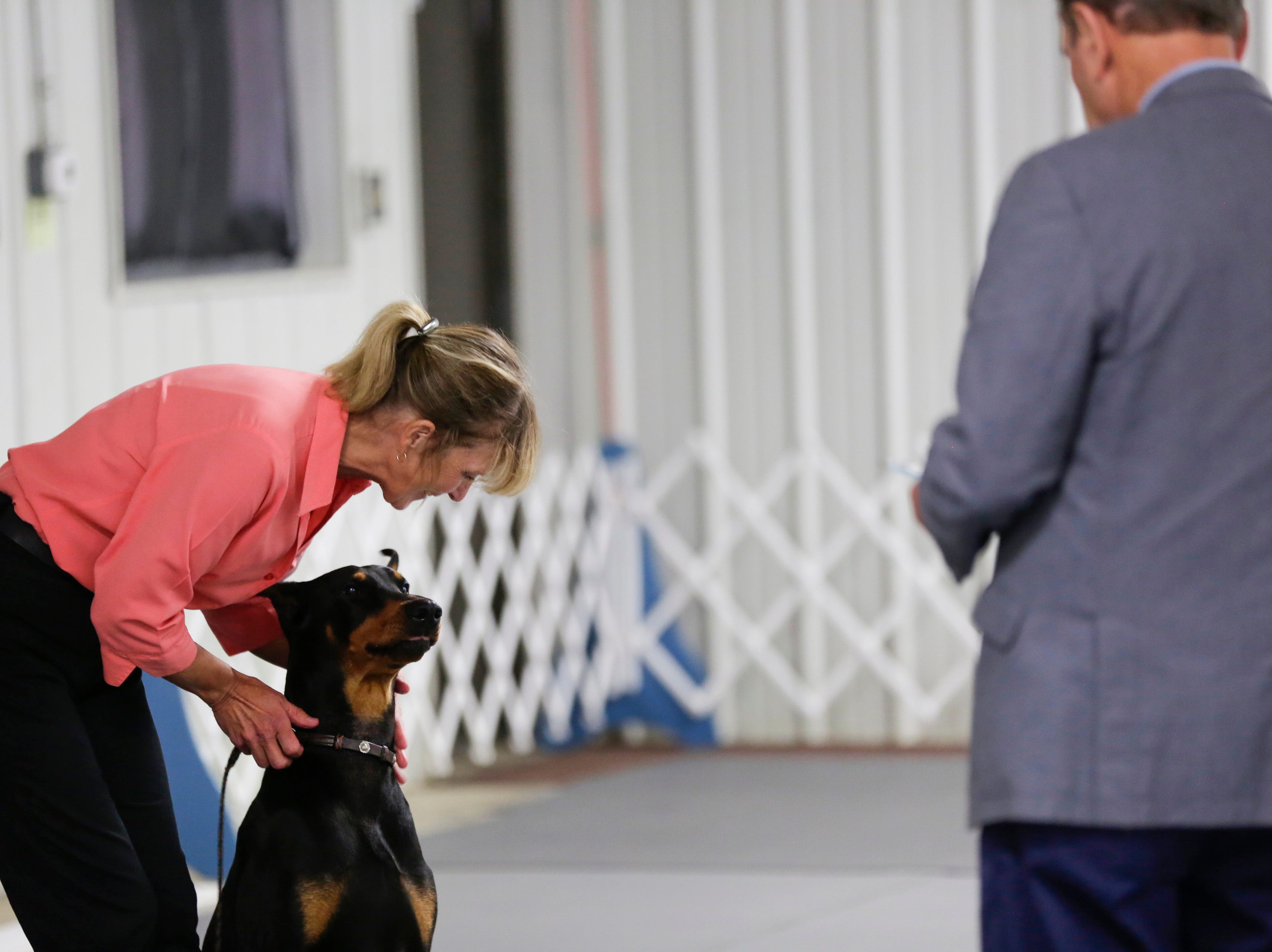 Cindy Bohnert competes with her Doberman pinscher Trek in the novice obedience class during the Marshfield Area Kennel Club's All-Breed Dog Show, Obedience Trials and Rally Trials at the Central Wisconsin Fairgrounds in Marshfield Saturday, August 18, 2018.