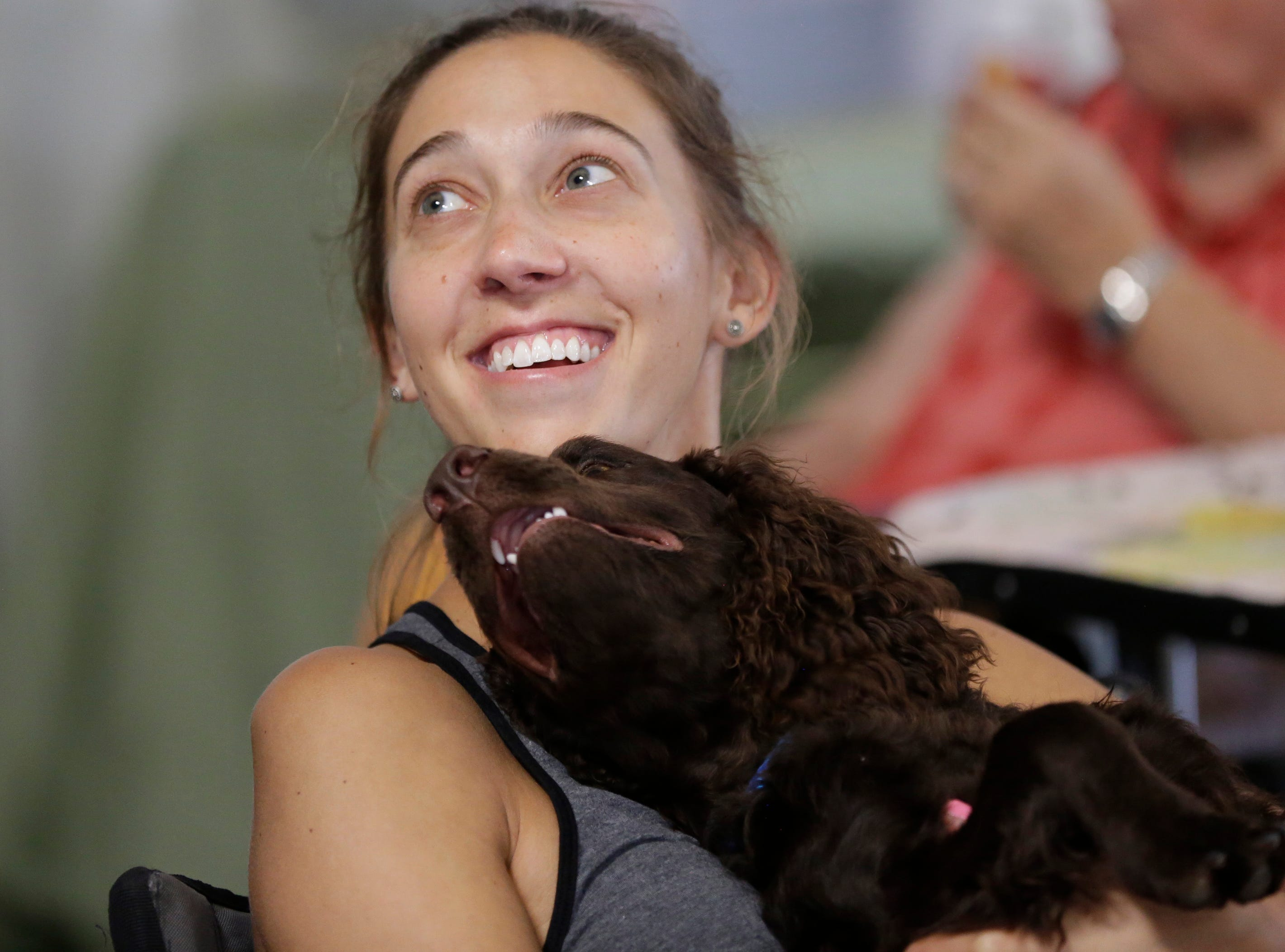 Bree Dravees cuddles with her American water spaniel Indee during the Marshfield Area Kennel Club's All-Breed Dog Show, Obedience Trials and Rally Trials at the Central Wisconsin Fairgrounds in Marshfield Saturday, August 18, 2018.