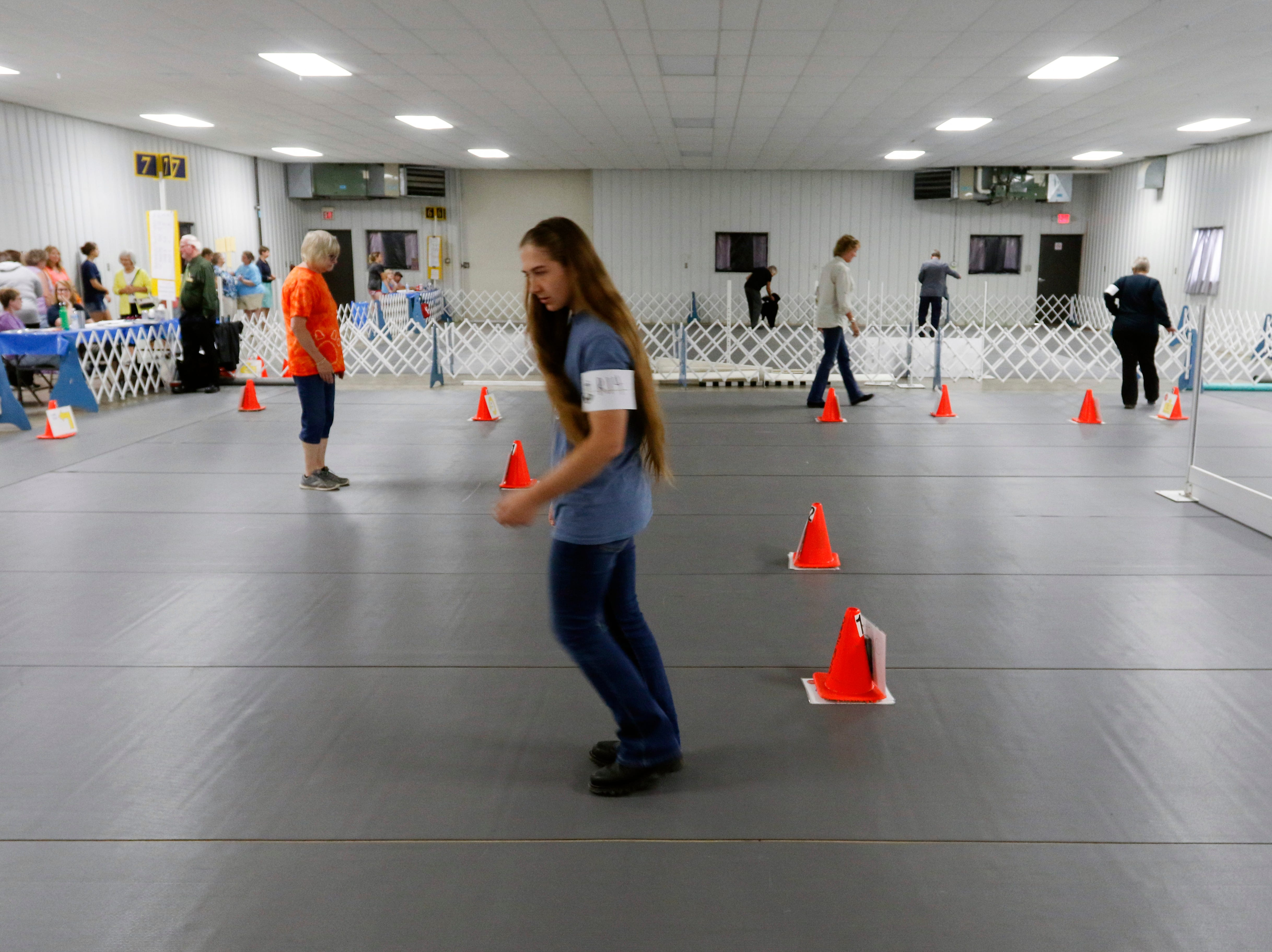 Sarah Stegall walks the rally master course to prepare to compete during the Marshfield Area Kennel Club's All-Breed Dog Show, Obedience Trials and Rally Trials at the Central Wisconsin Fairgrounds in Marshfield Saturday, August 18, 2018.